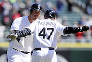 CHICAGO - APRIL 03:  Third base coach Joe McEwing #47 celebrates with Adam Dunn #32 of the Chicago White Sox after Dunn hit a home run in the second inning against the Kansas City Royals on April 3, 2013 at U.S. Cellular Field in Chicago, Illinois.  The White Sox defeated the Royals 5-2.  (Photo by Ron Vesely)   Subject: Joe McEwing; Adam Dunn