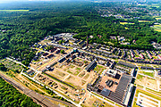 Nederland, Gelderland, Gemeente Ede-Wageningen, 29-05-2019; Ede, Heimanslaan. Voormalige fabrieksterrein van de Nederlandse Kunstzijdefabriek, het  ENKA-terrein van AkzoNobel. Een van de grootste gebouwen van de oude Enka-fabriek huisvest nu De Fietser (showroom, restaurant). Het voormalige industrieterrein wordt getransformeerd tot woonwijk.<br /> Former factory site of the Nederlandse Kunstzijdefabriek, the ENKA of AkzoNobel. The former industrial site is being transformed into a residential area.<br /> <br /> luchtfoto (toeslag op standard tarieven);<br /> aerial photo (additional fee required);<br /> copyright foto/photo Siebe Swart
