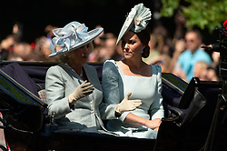 © Licensed to London News Pictures. 09/06/2018. London, UK. CAMILLA, DUCHESS OF CORNWALL and the DUCHESS OF CAMBRIDGE rides in a carriage to attend the Trooping The Colour ceremony in London. This years event is part of a weekend of celebration to mark the 92th birthday of Queen Elizabeth II, who is Britain's longest reigning monarch.Photo credit: Ray Tang/LNP