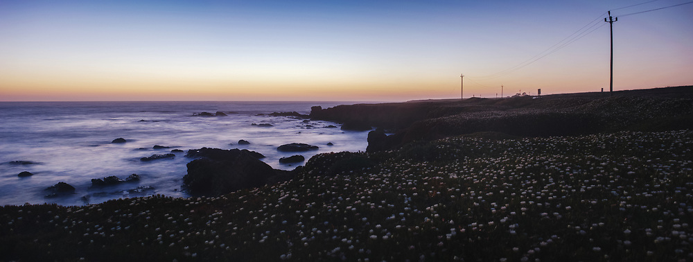 The shores surrounding Pigeon Point Lighthouse are seen just after sundown.