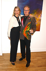Artist JEFFREY KROLL and SERENA MORTON at an exhibition of art by Jeffrey Kroll entitled Imirage held at the Arndean Gallery, Cork Street, London on 19th October 2005.<br /><br />NON EXCLUSIVE - WORLD RIGHTS