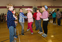 """Inter Lakes Elementary School's annual Square Dance has third graders Charlie Despres and Kayley Wagoner chasse down the line with their fellow """"partners"""" Thursday afternoon.   (Karen Bobotas/for the Laconia Daily Sun)"""