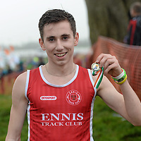 15 December 2013; Kevin Mulcaire, from Ennis Track Club, Co. Clare, celebrates with his medal after winning the Boys under-17 5000m at the Woodie's DIY National Novice & Even Age Cross Country Championships. WIT Sports Campus, Carriganore, Co. Waterford. Picture credit: Matt Browne / SPORTSFILE *** NO REPRODUCTION FEE ***