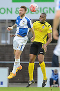 Chesham United defender Curtis Ujah beats Bristol Rovers striker Matt Taylor to a header during the The FA Cup match between Bristol Rovers and Chesham FC at the Memorial Stadium, Bristol, England on 8 November 2015. Photo by Alan Franklin.