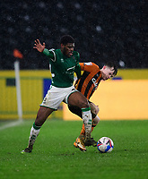 Lincoln City's Timothy Eyoma battles with Hull City's Keane Lewis-Potter<br /> <br /> Photographer Andrew Vaughan/CameraSport<br /> <br /> EFL Trophy Quarter Final - Hull City v Lincoln City - Tuesday 2nd February 2021 - KCOM Stadium - Kingston upon Hull<br />  <br /> World Copyright © 2021 CameraSport. All rights reserved. 43 Linden Ave. Countesthorpe. Leicester. England. LE8 5PG - Tel: +44 (0) 116 277 4147 - admin@camerasport.com - www.camerasport.com