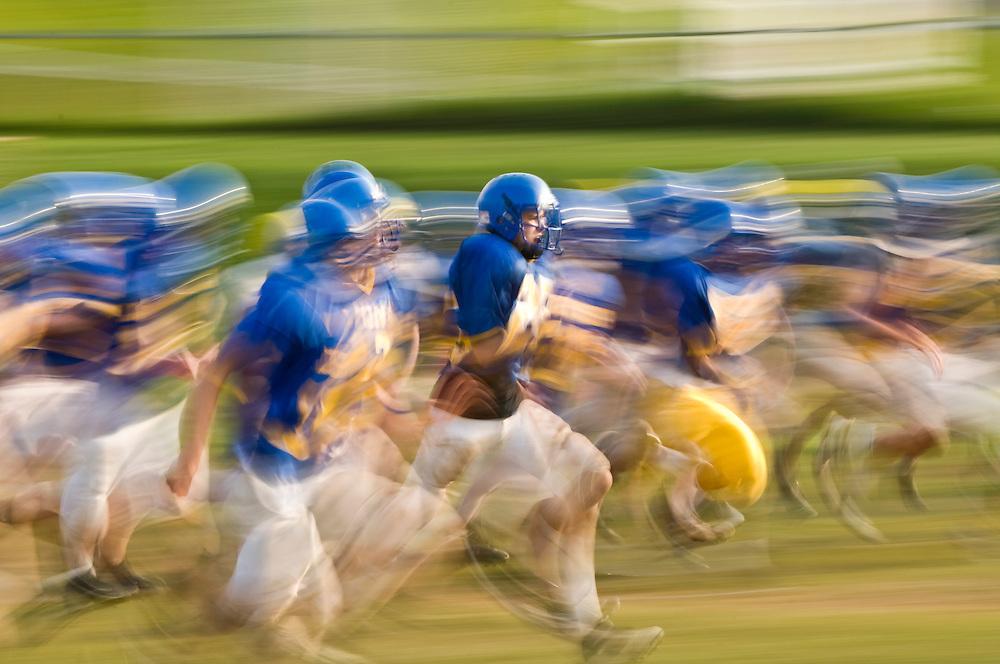 (staff photo by Matt Roth)..Varsity players run sprints during Liberty High School's football practice Wednesday, August 19, 2009...