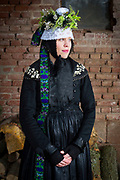 Nadine, member of the 'Trachtengruppe Wollmar' is wearing an original traditional bridal costume from Marburg (Marburger Tracht) in Wollmar, Hesse, Germany on November 12, 2016.<br /> <br /> Only pristine women were allowed to wear the bridal crown.<br /> <br /> This is part of the series about Traditional Wedding Gowns from different regions of Germany, worn by young members of local dance groups and cultural associations that exist to preserve and celebrate the cultural heritage. The portraiture series is a depiction of an old era with different social values and religious beliefs in an antiquated civil society with very few of those dresses left.