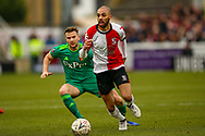 Woking forward Christian Jolley holds off Watford midfielder Tom Cleverley (8) during the The FA Cup 3rd round match between Woking and Watford at the Kingfield Stadium, Woking, United Kingdom on 6 January 2019.