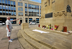 © Licensed to London News Pictures. 01/06/2013. Bristol, UK.  A  man denies that he is a member of the English Defence League when challenged by anti-fascist protestors at the cenotaph in Bristol city centre. Flowers and signs are laid at the Cenotaph in Bristol in memory of soldier Lee Rigby, who was murdered in Woolwich in May 2013.  It was rumoured that the English Defence League would attend but no one admitted to being a member of the EDL.  Anti-fascist protestors gathered close by. 01 June 2013.<br /> Photo credit : Simon Chapman/LNP