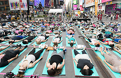 June 21, 2017 - New York, New York, U.S. - People on their backs during a huge group yoga session in Times Square in honor of summer solstice in New York City. (Credit Image: © Michael Brochstein via ZUMA Wire)