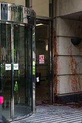Fake blood sprayed onto the wall of the Department for Transport by activists from HS2 Rebellion, an umbrella campaign group comprising longstanding campaigners against the HS2 high-speed rail link as well as Extinction Rebellion activists, during a protest on 4 September 2020 in London, United Kingdom. Activists glued themselves to the doors and pavement outside the building and sprayed fake blood around the entrance during a protest which coincided with an announcement by HS2 Ltd that construction of the controversial £106bn high-speed rail link will now commence.