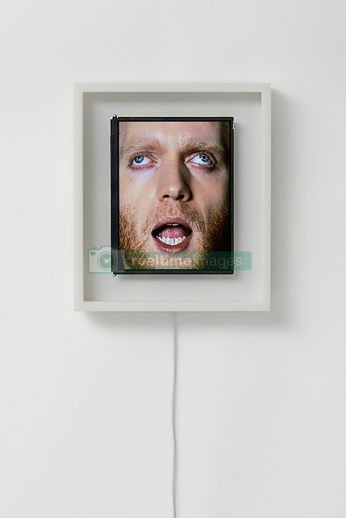 "August 7, 2017 - inconnu - Here's a new way to enjoy face-time.It's a set of clocks featuring moving human faces.The left and right eyes act as hands, looking in the direction the hand would face. The mouth opens and closes as the seconds counter, also making the sound of a clock's ticks.The clock is literally a screen that displays a human face. Japananese creative studio We+ made the quirky clock by video-recording real human faces in three separate films – each eye and mouthThe team then merged them seamlessly together in a 24 hour looped video. Tokyo-based We+ is made up of designers Hokuto Ando and Toshiya Hayashi.They develop their experimental approach to products, installations and graphics, by combining unconventional materials and technology to shift perspectives. The said:"" Patience clock which uses a human face to represent the passage of time. ""The eyes work in the same way as an analogue clock's hands, with the right eye indicating hours and the left eye indicating minutes. ""The mouth opens and closes to represent seconds # HORLOGES AVEC DES VISAGES HUMAINS (Credit Image: © Visual via ZUMA Press)"