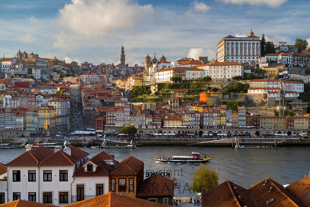 Rabelo port wine barge and historic river front of the Ribeira region of Porto from Vila Nova de Gaia in Portugal
