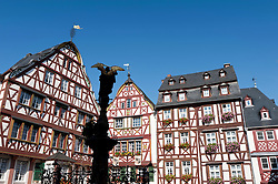 Old half-timbered houses in square in Bernkastel-Kues village on River Mosel in Mosel valley in Germany