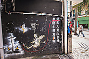 Graffiti art by Gantz 5 on a wall in Macau.