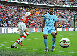 Arsenal's Aaron Ramsey battles for the ball with Manchester City's Gael Clichy - Photo mandatory by-line: Joe Meredith/JMP - Mobile: 07966 386802 10/08/2014 - SPORT - FOOTBALL - London - Wembley Stadium - Arsenal v Manchester City - FA Community Shield