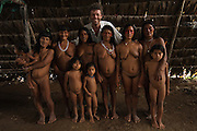 Pete Oxford with a group of Huaorani Indians.<br /> Bameno Community. Yasuni National Park.<br /> Amazon rainforest, ECUADOR.  South America<br /> This Indian tribe were basically uncontacted until 1956 when missionaries from the Summer Institute of Linguistics made contact with them. However there are still some groups from the tribe that remain uncontacted.  They are known as the Tagaeri & Taromenane. Traditionally these Indians were very hostile and killed many people who tried to enter into their territory. Their territory is in the Yasuni National Park which is now also being exploited for oil.