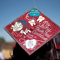 Danielle Benally wears a decorated graduation cap as she lines up to receive her dental assisting certificate Friday morning at the University of New Mexico-Gallup Spring 2021 commencement ceremony at Angelo DiPaolo Memorial Stadium in Gallup.