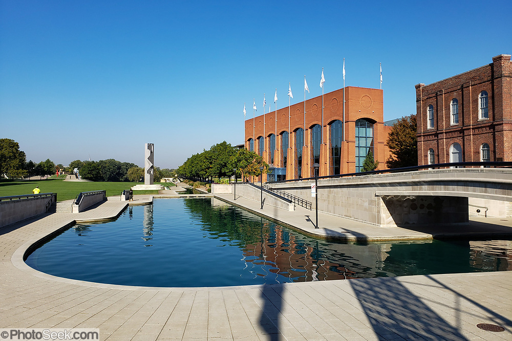 NCAA Hall of Champions, on the Indiana Central Canal, Indianapolis, Indiana, USA. Indiana Central Canal was dug in the early 1800s to facilitate interstate commerce, but the project was cut short due to financial problems. Today, the refurbished Canal Walk (stretching north through White River State Park to 11th Street) serves the downtown community as a waterside promenade for walkers, runners, bikers, and sightseers.