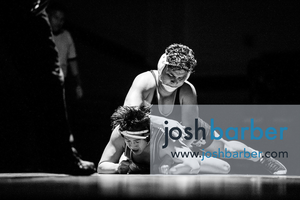Aliso Niguel's Josh Mackey, Capistrano Valley's Gerado Hernandez during Sea View league wrestling at Capistrano Valley High School on Thursday, January 14, 2016 in Mission Viejo, California. Capistrano Valley won 43-22. (Photo/Josh Barber)