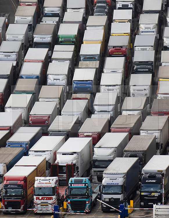 © Licensed to London News Pictures. 18/12/2020. Dover, UK. Trucks queue up for ferries at the Port of Dover. Retailers are suggesting that delays at some ports are causing shortages of goods in the shops this Christmas. Photo credit: Peter Macdiarmid/LNP