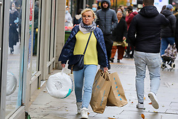 © Licensed to London News Pictures. 01/11/2020. London, UK. A woman carrying Primark shopping bags in north London, as panic buying continues. This is following the announcement of the second lockdown in England from Thursday 5 November until Wednesday 2 December,  as coronavirus cases are increasing. Non-essential shops such as Primark will close of Thursday. Minister for the Cabinet Office, Michael Gove, has said that the four-week shut-down could be extended into December if needed. Photo credit: Dinendra Haria/LNP