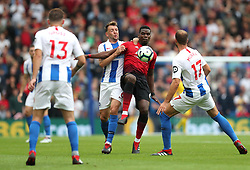 """Manchester United's Paul Pogba (centre) battles for the ball with Brighton & Hove Albion's Dale Stephens (left) and Glenn Murray (right) during the Premier League match at the AMEX Stadium, Brighton. PRESS ASSOCIATION Photo. Picture date: Sunday August 19, 2018. See PA story SOCCER Brighton. Photo credit should read: Gareth Fuller/PA Wire. RESTRICTIONS: EDITORIAL USE ONLY No use with unauthorised audio, video, data, fixture lists, club/league logos or """"live"""" services. Online in-match use limited to 120 images, no video emulation. No use in betting, games or single club/league/player publications."""