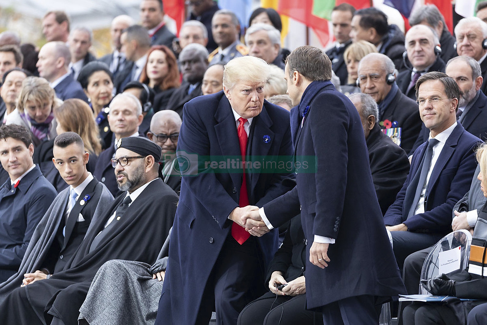 November 11, 2018 - Paris, France - U.S President Donald Trump, center, shakes hands with French President Emmanuel Macron before the start of events marking the Centennial of Armistice Day at the Arc de Triomphe November 11, 2018 in Paris, France. Armistice Day marks the end of World War I. (Credit Image: © Shealah Craighead via ZUMA Wire)