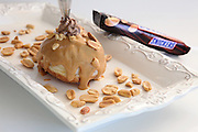 Sufganiyah (Sufganyot) a traditional Jewish Doughnut eaten during Hanukkah with chocolate and nuts Snickers flavour