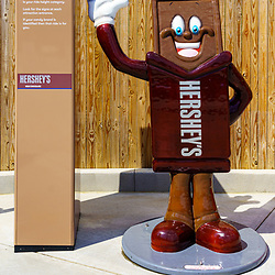 Hershey, PA, USA - September 4, 2020: Chocolate characters show height requirements for rides at the entrance of Hersheypark.
