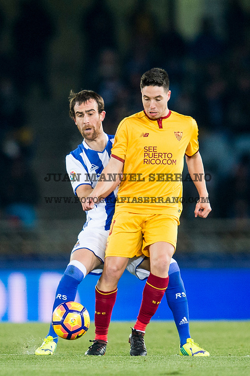 SAN SEBASTIAN, SPAIN - JANUARY 07:  Samir Nasri of Sevilla FC duels for the ball with Mikel Gonzalez of Real Sociedad during the La Liga match between Real Sociedad de Futbol and Sevilla FC at Estadio Anoeta on January 7, 2017 in San Sebastian, Spain.  (Photo by Juan Manuel Serrano Arce/Getty Images)
