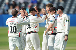 Kyle Jarvis for Lancashire Cricket celebrates with his team mates after Chris Dent of Gloucestershire is caught out from his bowl - Photo mandatory by-line: Dougie Allward/JMP - Mobile: 07966 386802 - 07/06/2015 - SPORT - Football - Bristol - County Ground - Gloucestershire Cricket v Lancashire Cricket - LV= County Championship