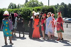 © Licensed to London News Pictures. 21/06/2018. London, UK. A group of women pose for a photograph as the arrive for Ladies Day at Royal Ascot at Ascot racecourse in Berkshire, on June 21, 2018. The 5 day showcase event, which is one of the highlights of the racing calendar, has been held at the famous Berkshire course since 1711 and tradition is a hallmark of the meeting. Top hats and tails remain compulsory in parts of the course. Photo credit: Ben Cawthra/LNP