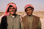 Bedouin camel herders at Rumaila oil field in southern Iraq. The Rumaila field is one of Iraq's biggest oil fields with five billion barrels in reserve. Many of the wells are 10,000 feet deep and produce huge volumes of oil and gas under tremendous pressure, which makes capping them very difficult and dangerous. Rumaila is also spelled Rumeilah.