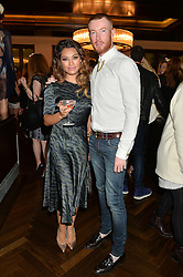 Left to right, Singer VANESSA WHITE and SEAN NOLAN at a party to celebrate the 15th anniversary of Myla held at the House of Myla, 8-9 Stratton Street, London on 21st October 2014.