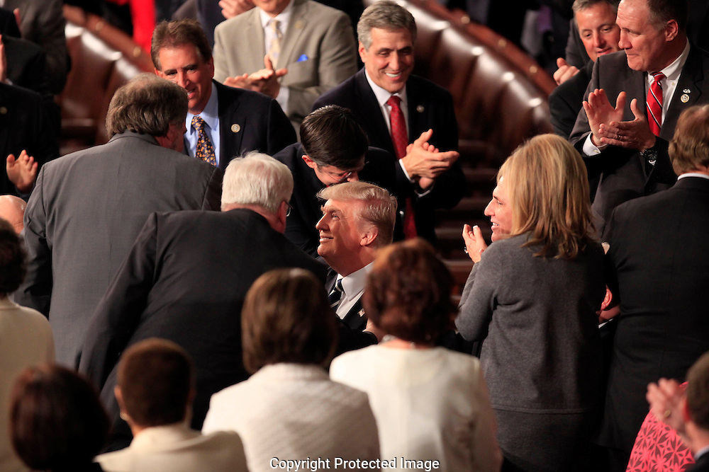 President Donald Trump  shakes hands with Representatives as he arrives in the House of Representatives Chamber to give  a speech to a joint session of Congress on February 28, 2017<br /> <br /> Photo by Dennis Brack