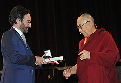 Dalai Lama during the ceremony for honorary citizenship, during the meeting organized by the University Bicocca to the Arcimboldi theater, given by Lamberto Bertole (left)