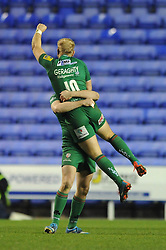London Irish fly half, Shane Geraghty celebrates with team mates after scoring a last minute drop goal to make it 28 26 - Photo mandatory by-line: Dougie Allward/JMP - Mobile: 07966 386802 - 11/01/2015 - SPORT - RUGBY - Reading - Madejski Stadium - London Irish v Exeter Chiefs - Aviva Premiership