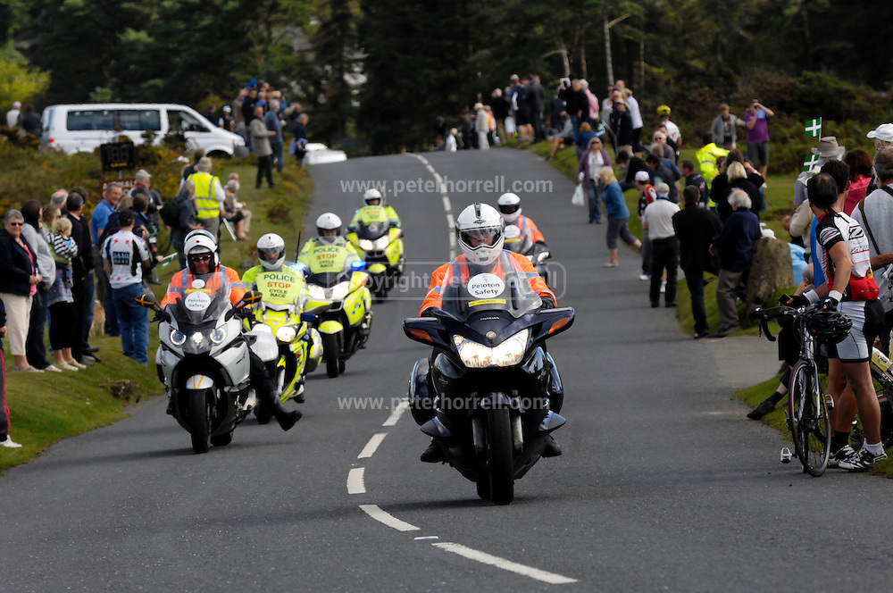 UK, September 15 2011: Motorcycle riders on the climb to Haytor during the fifth stage of the 2011 Tour of Britain. The riders escort the Tour of Britain race  The stage started in Exeter and finished in Exmouth. Copyright 2011 Peter Horrell
