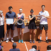PARIS, FRANCE June 10. Desirae Krawczyk of the United States and Joe Salisbury of Great Britain with the winners trophy after winning the mixed doubles final and Elena Vesnina and Aslan Karatsev of Russia with the runners up trophies during the presentation ceremony on Court Philippe-Chatrier during the 2021 French Open Tennis Tournament at Roland Garros on June 10th 2021 in Paris, France. (Photo by Tim Clayton/Corbis via Getty Images)