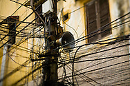 Network of wires surrounds an old speaker used for daily public propaganda, Hanoi, Vietnam, Southeast Asia
