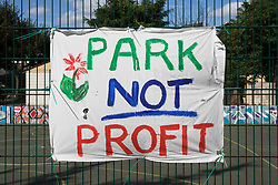 A Park Not Profit banner prepared by local residents and campaigners is displayed on fencing around sports facilities at Bells Gardens in Peckham on 14th August 2021 in London, United Kingdom. Southwark Council proposes to build 97 new homes (a mix of social and private housing), a reprovisioned community facility and a multi-use games area at Bells Gardens, a well-used community park serving the 545-home Bells Gardens estate. Southwark ranks fifth-worst in London and eighth-worst in the UK for easy access to green space.