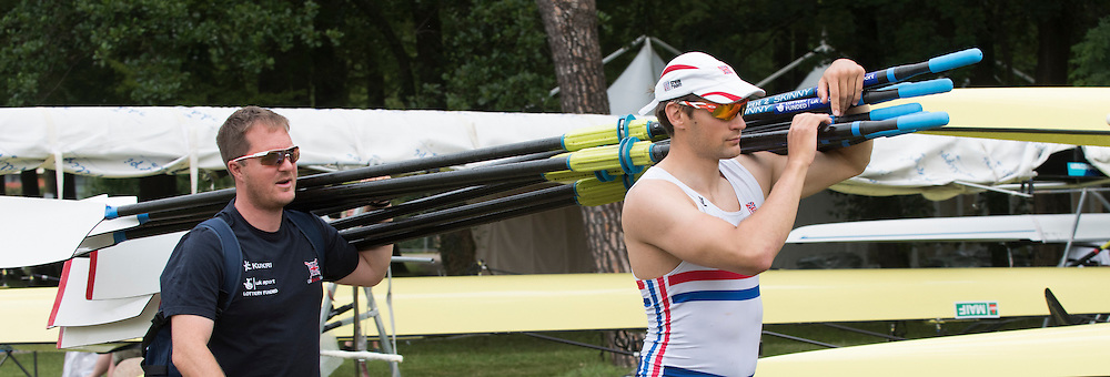 Varese. ITALY.  coach Paul STANNARD and Graeme THOMAS, carrying the sculls/oars.  2015 FISA World Cup II Venue Lake Varese. Thursday  18/06/2015 [Mandatory Credit: Peter Spurrier/Intersport images]