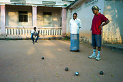 Men play a game of Pétanque at the Cercle Sportif Ponicherry, Pondicherry, India. Pondicherry now Puducherry is a Union Territory of India and was a French territory until 1954 legally on 16 August 1962. The French Quarter of the town retains a strong French influence in terms of architecture and culture.