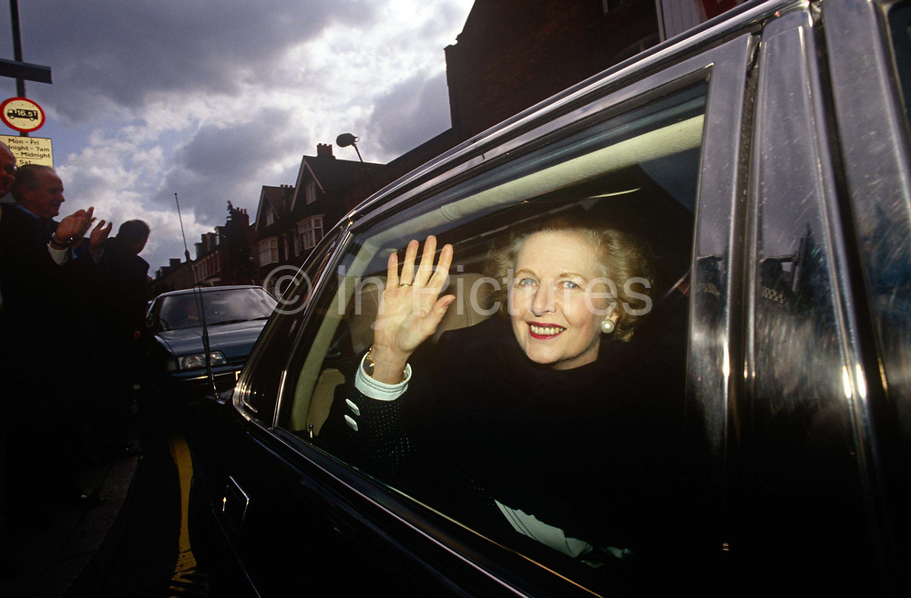 Ex-Prime Minister Margaret Thatcher leaves former Finchley constituence while campaigning for John Major's 1992 election. Two years after her colleagues deposed her, forcing her to resign from her 11 year premiership she is still in favour by Conservatives who are proud to display her in public, before eventually shunning her policies and profile for their campaigns. Waving from her car, she departs a constituency rally where her her appearence is appreciated by supporters for premier John Major. Thatcher has been lending her support to the election campaign of her replacement, John Major who went on to win and govern until his defeat in 1997 to Labour's Tony Blair.