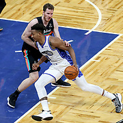 ORLANDO, FL - APRIL 12: Wendell Carter Jr. #34 of the Orlando Magic drives to the net past Jakob Poeltl #25 of the San Antonio Spurs during the second half at Amway Center on April 12, 2021 in Orlando, Florida. NOTE TO USER: User expressly acknowledges and agrees that, by downloading and or using this photograph, User is consenting to the terms and conditions of the Getty Images License Agreement. (Photo by Alex Menendez/Getty Images)*** Local Caption *** Wendell Carter Jr.; Jakob Poeltl