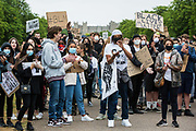 Hundreds of young people pause for a song and speeches during a peaceful protest march in solidarity with the Black Lives Matter movement on 4th June 2020 in Windsor, United Kingdom. The march, along the Long Walk in front of Windsor Castle, was organised at short notice by Jessica Christie at the request of her daughter Yani, aged 12, following the death of George Floyd while in the custody of police officers in Minneapolis in the United States.