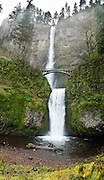 Multnomah Falls plunges 620 feet in two tiers in Columbia River Gorge National Scenic Area, adjacent to Interstate 84 and Historic Columbia River Highway, in Oregon, USA. A foot trail leads to Benson Footbridge, a 45-foot (14 m) long footbridge that allows visitors to cross 105 feet (32 m) above the lower cascade. Panorama stitched from 6 overlapping images.