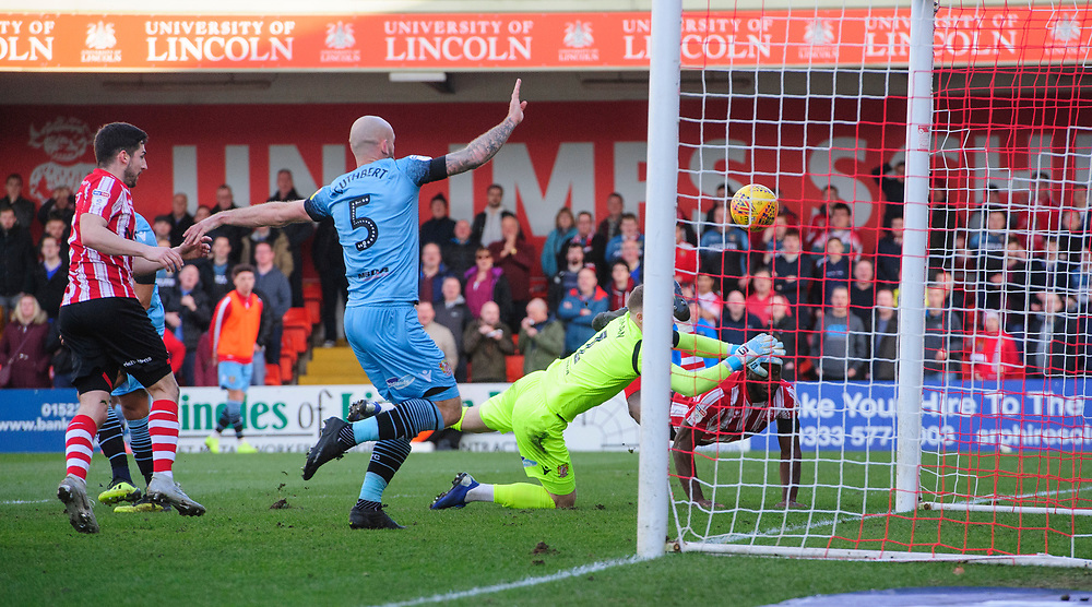 A header from Lincoln City's John Akinde, under pressure from Stevenage's Paul Farman, is cleared off the line by Stevenage's Scott Cuthbert<br /> <br /> Photographer Chris Vaughan/CameraSport<br /> <br /> The EFL Sky Bet League Two - Lincoln City v Stevenage - Saturday 16th February 2019 - Sincil Bank - Lincoln<br /> <br /> World Copyright © 2019 CameraSport. All rights reserved. 43 Linden Ave. Countesthorpe. Leicester. England. LE8 5PG - Tel: +44 (0) 116 277 4147 - admin@camerasport.com - www.camerasport.com