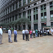 A line of lunch time customers at a mobile street vendor selling food in the business district in downtown Manhattan,  New York City, USA. 16th September 2014. Photo Tim Clayton